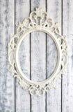 White wooden wall with vintagewhite frame. White wooden wall with vintage white frame Royalty Free Stock Photos
