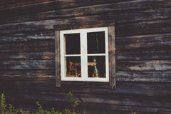 White Wooden Window Frame Mounted in Brown Wooden Wall Stock Images