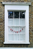 White wooden window. The white wooden window of little building Royalty Free Stock Photo