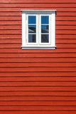 White wooden window on the red wooden house wall. White wooden window on the traditional red wooden house wall, Norway, with copy space Royalty Free Stock Photo