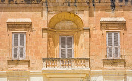 White wooden window shutters. Three windows in Mdina, Malta Stock Images