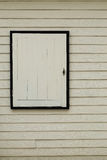 White wooden window on vintage wood wall Stock Photos