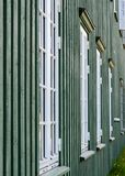 White wooden windows and green walls Royalty Free Stock Photography