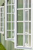 White wooden windows and green walls Stock Photo