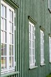 White wooden windows and green walls Stock Photos