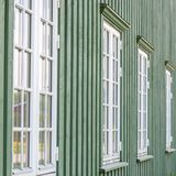 White wooden windows and green walls Royalty Free Stock Images