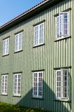 White wooden windows and green walls Stock Image