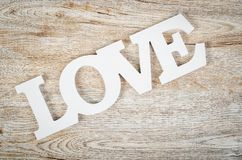 White wooden word love on wooden. royalty free stock photos