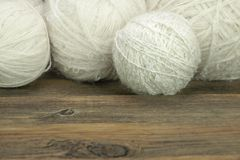 White Wool Rolls On Wood Background Royalty Free Stock Photos