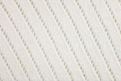 White woolen knitted fabric background Royalty Free Stock Images