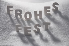 White Word Frohes Fest Means Merry Christmas On Snow Royalty Free Stock Photography