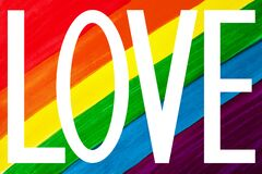 Free White Word LOVE Isolated On Rainbow Colors Background Close Up, LGBT Community Flag Banner, LGBTQ Pride Poster, Letter Love Sign Royalty Free Stock Image - 173385716