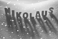 White Word Nikolaus Means St Nicholas On Snow, Snowflakes Stock Photo