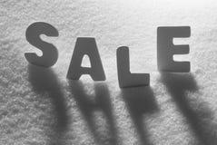 White Word Sale On Snow Stock Photo