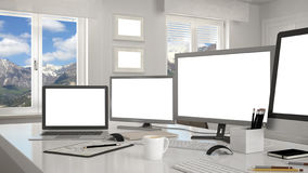 White workplace with computers on a desk Royalty Free Stock Images