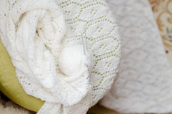 White woven handicraft knitting detail. Detail of woven handicraft knit woolen design texture and clew. Fabric white background stock images
