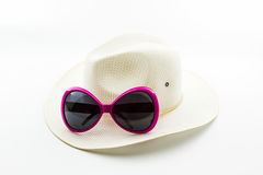 White woven hat with pink sunglasses. Stock Photos