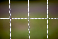 White woven wire fence background Stock Photos