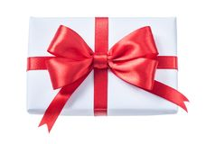 White wrapped gift box with red ribbon isolated on white.  Stock Photos