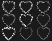 White wreath frames in the shape of hearts Stock Images