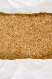 White wrinkle paper on cork background Stock Images