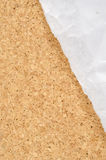 White wrinkle paper on cork background Royalty Free Stock Images