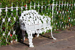 White wrought iron bench Stock Image
