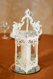 White wrought-iron candlestick. The decor of the room. Stock Photo