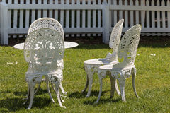 White wrought iron garden furniture. White cast iron garden furniture Royalty Free Stock Photo