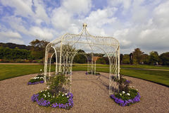 White wrought iron gazibo. Stock Photography