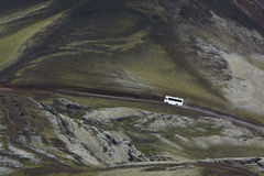 White 4x4 bus on a road in highlands, Iceland Stock Images