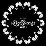 White Xmas hand  lettering  with  holly sprig. Stock Photography