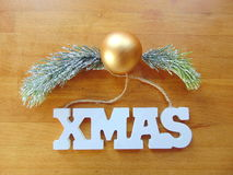 White Xmas letters with christmas decoration on wood. White Xmas letters with christmas ball and pine above stock photo