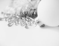 White xmas ornaments on white background. With space for text Royalty Free Stock Photos