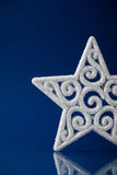 White xmas star on dark blue christmas background Royalty Free Stock Image