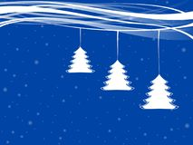 Xmas trees with white ribbons and snowflakes. White xmas trees hanging on a white ribbons against blue background Stock Images