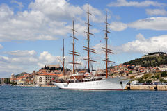 White yacht. Large sailing boat with white sails docked at Sibenik port, Croatia Royalty Free Stock Photography