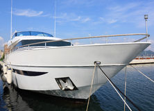White yacht. A large private motor yacht on harbor Royalty Free Stock Photo