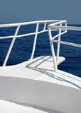 White Yacht. On the White Yacht Bow in High Seas. Midday Royalty Free Stock Image