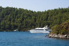 White yacht in Aegean Sea. Motor yacht moored in the harbour of Aegean Sea, Turkey Royalty Free Stock Image