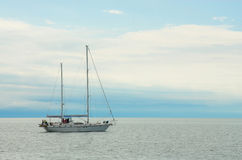 White yacht, Baikal, Russia. Yacht on the water, Baikal, Russia Stock Images