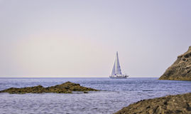 White yacht in bay. White yacht in the bay on a clear day in summer in Crimea, Ukraine Stock Photos