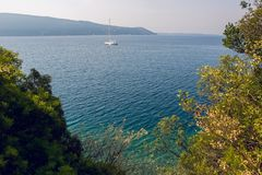 White yacht is in the Bay of Montenegro Royalty Free Stock Photography