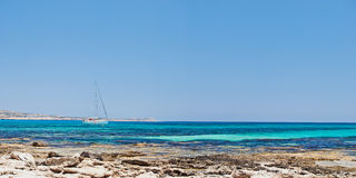 White yacht in the bay near the coast of Cyprus Royalty Free Stock Photo