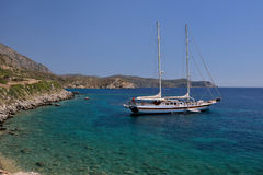 White yacht in a beautiful Aegean bay in Knidos, Mugla, Turkey. Royalty Free Stock Photography