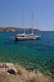 White yacht in a beautiful Aegean bay in Knidos, Mugla, Turkey. Royalty Free Stock Photos