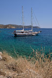 White yacht in a beautiful Aegean bay in Knidos, Mugla, Turkey. Stock Photos