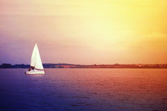 White yacht and beautiful sunset Stock Image