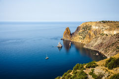 White yacht in black sea. White yacht on stunning bay in Crimea Stock Images