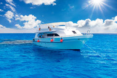 White yacht in the blue tropical sea Stock Photos